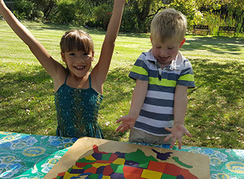 kids playing with wooden puzzle